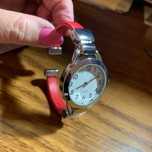 Avon red/silvertone cuff watch
